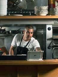 Fast food restaurant worker preparing customer orders